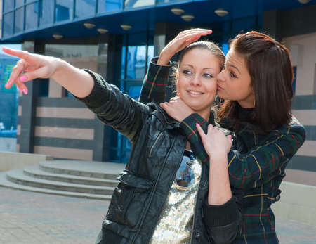 lesbian sexy: Two young girls embracing on a street Stock Photo