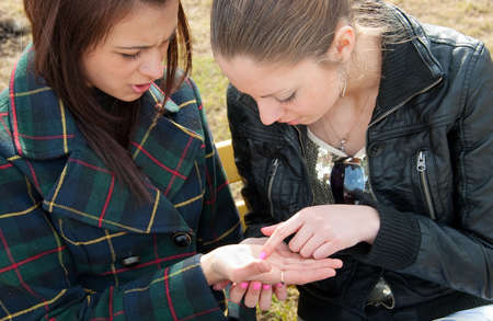 Chiromancy - girls examine lines on a palm