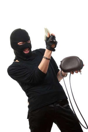 Happy robber takes money from stolen handbag. Isolated over white. Stock Photo - 4941094