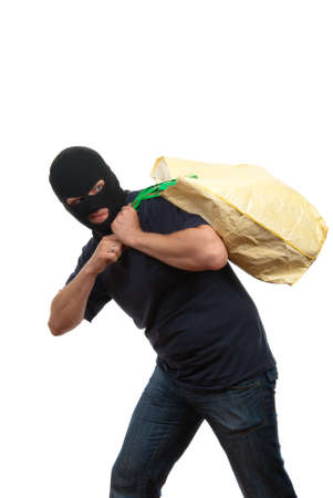 Robber in a mask carries big bag with money Stock Photo - 4941107