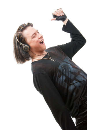 Young man listens to music in ear-phones. Isolated over white in studio Stock Photo - 5072748