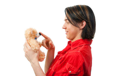 sensible: Young guy with his loved  from childhood toy - teddy bear. Isolated over white in studio.