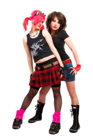 fanatic studio: Portrait of two punk girls isolated over white in studio