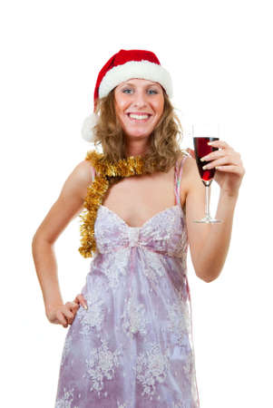 Girl in Santa hat with a glass of wine photo