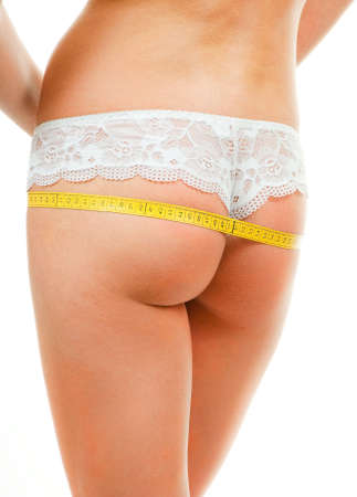 Woman ass measuring isolated over white background photo