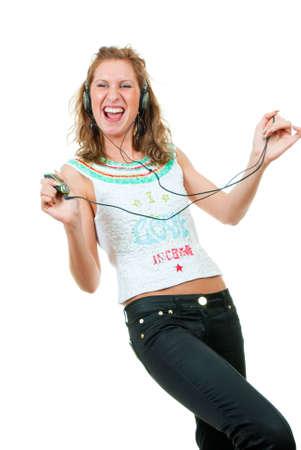 Girl enjoys listening to music isolated over white background Stock Photo - 5519035
