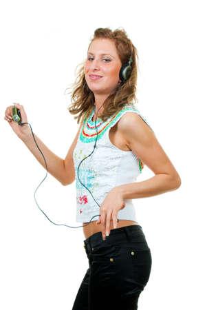 Girl enjoys listening to music isolated over white background Stock Photo - 5519041
