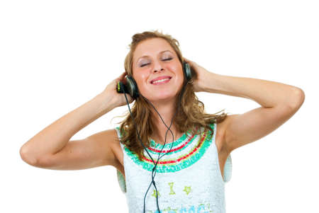 Girl enjoys listening to music isolated over white background Stock Photo - 5518997