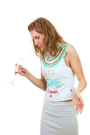 Drunk woman looks at an empty glass, isolated over white Stock Photo - 5518987