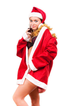 Young sexy Santa Girl with glass of wine isolated on white background   photo