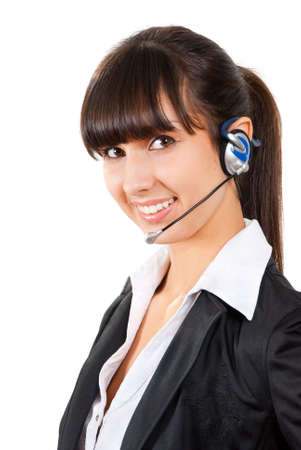 Smiling pretty business woman with headset. Isolated over white background   photo