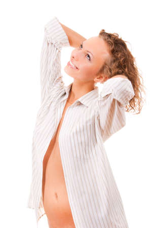 Beautiful girl in a man's shirt wakes up and stretches Stock Photo - 5781281