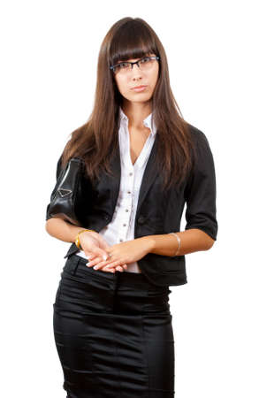 Serious young business woman. Isolated over white background photo