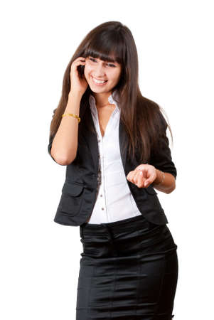 Young business woman speaking by mobile phone Stock Photo - 5793523