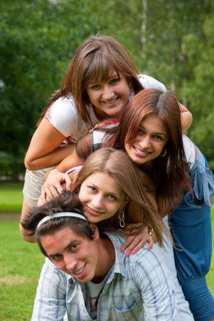Four young playful friends portrait in the park Stock Photo - 5807523