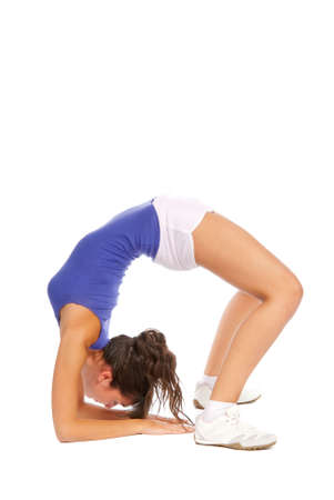 Flexible woman stretching and doing back-bend. Isolated on white background   photo