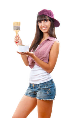 Beautiful young girl is going to paint something photo