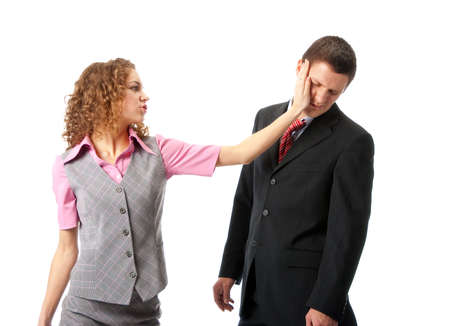violence in the workplace: Girl slapping in the face to man. Isolated over white