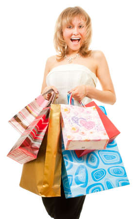 Happy girl after successful shopping with bags in her hands. Stock Photo - 6037783