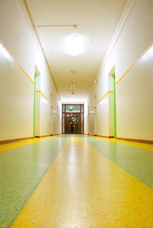 Perspective view of the corridor with door at the end   photo