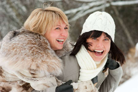 Two happy middle-aged women in winter nature Stock Photo - 6502860
