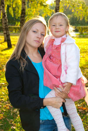 Happy mother and daughter in the park Stock Photo - 6539904