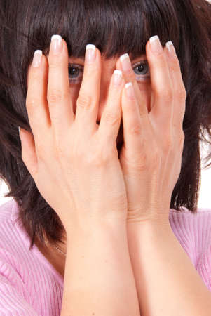 Woman hides her face in her hands photo