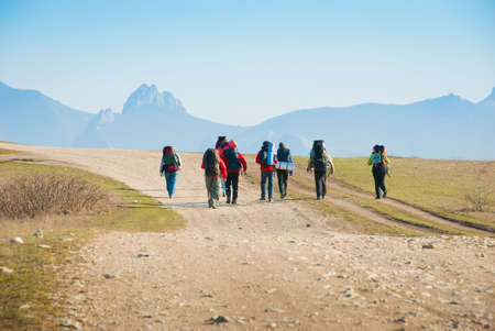 adventure sports: Hikers walk along the rocky footpath Stock Photo