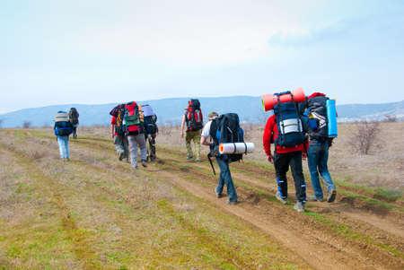 Hikers walk along the footpath photo