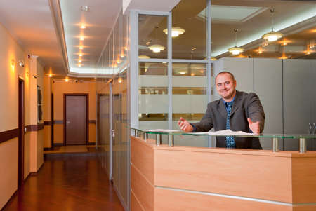 business reception: Affable businessman in the modern office interior