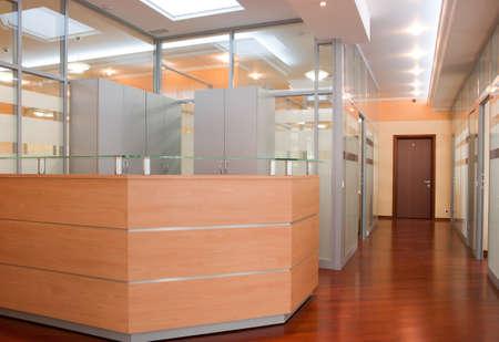 desk area: Modern office interior - reception and perspective of corridor