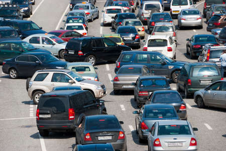 car traffic: Traffic jam on the road, a lot of cars which go towards each other and to the different directions