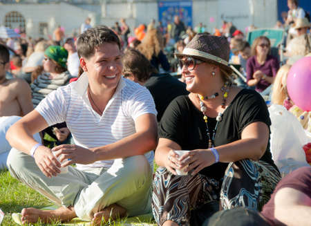 openair: Young couple relaxing at a open-air  music festival Stock Photo