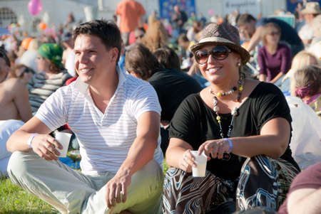 summer festival: Young couple relaxing at a open-air  music festival Stock Photo