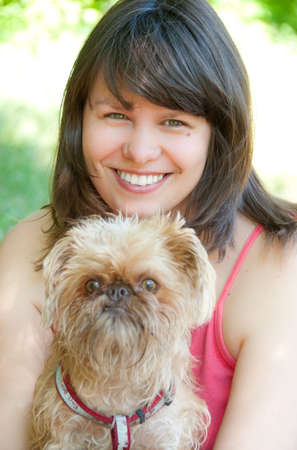 Young woman with dog. Breed - Griffon Bruxellois. Stock Photo - 7348374