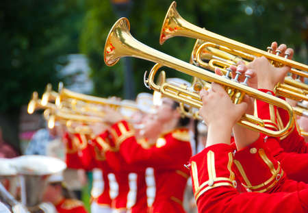 band: Girl Brass Band in red uniform performing Stock Photo