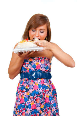 Girl wants to eat a whole cake. Stock Photo - 7348343