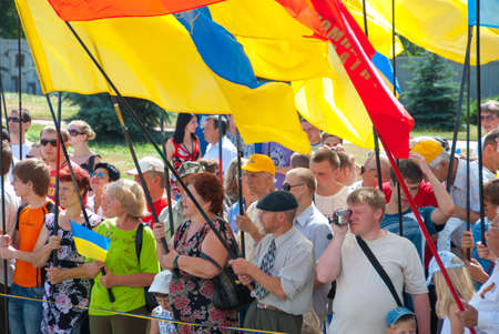 sumy: SUMY - JUNE 28: People stand with the flags of different parties, celebration of the Constitution of Ukraine on June 28, 2010 in Sumy, Ukraine