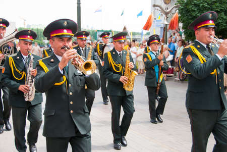 sumy: SUMY - JUNE 28: Military brass band performing at celebration of the Constitution of Ukraine on June 28, 2010 in Sumy, Ukraine