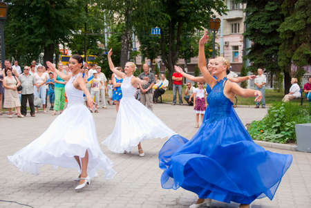 sumy: SUMY - JUNE 28: Women dancers on the town square performing on the Constitution of Ukraine on June 28, 2010 in Sumy, Ukraine