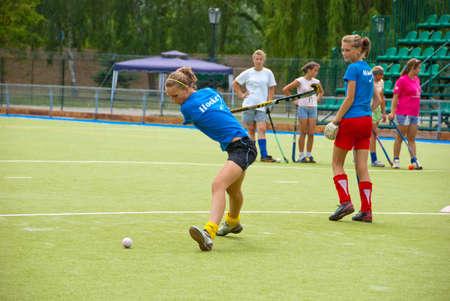SUMY, UKRAINE - JUNE 28: Bandy girl team training on a stadium 28, 2010 in Sumy, Ukraine