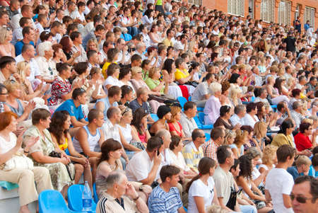 spectators: SUMY, UKRAINE - JUNE 28: The audience in the stands at a football match 28, 2010 in Sumy, Ukraine