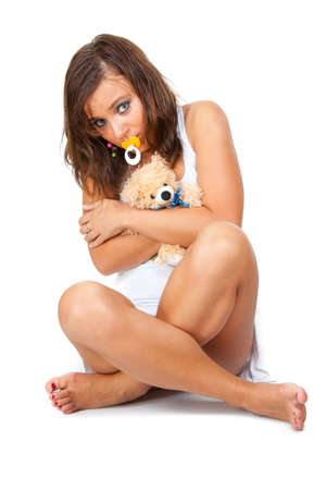 suck: Frightened girl hugging teddy bear and sucking a pacifier