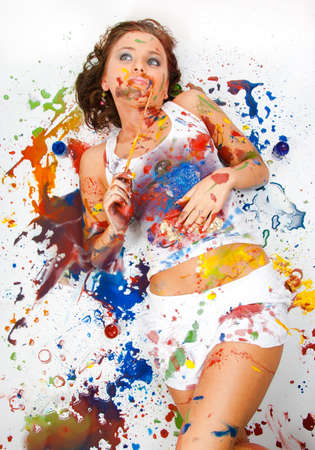 Girl lies and dreams, she was all smeared in paint Stock Photo - 7845137