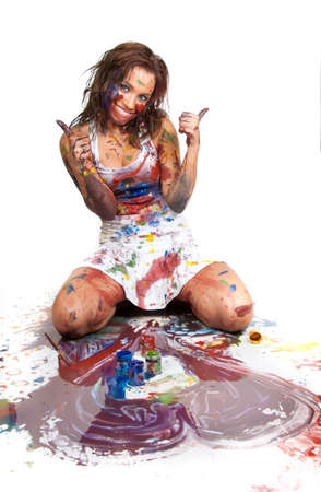 Covered in paint happy girl draws the heart Stock Photo - 7845128