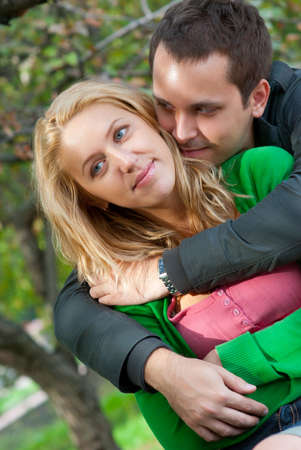 Beautiful young couple embracing in a park Stock Photo - 7941885