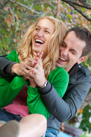 Beautiful young happy couple in a park photo