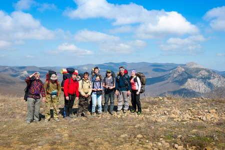 tourists stop: Hikers group on a peak in mountains   Stock Photo