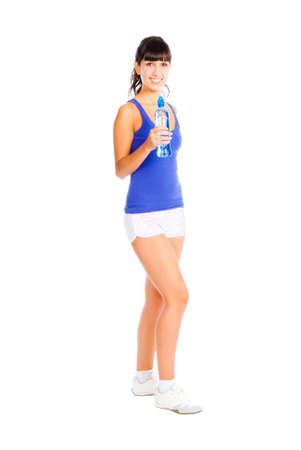 Young woman with bottle in the hand after fitness. Isolated over white photo