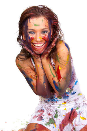 Happy girl, she is all smeared in paint photo